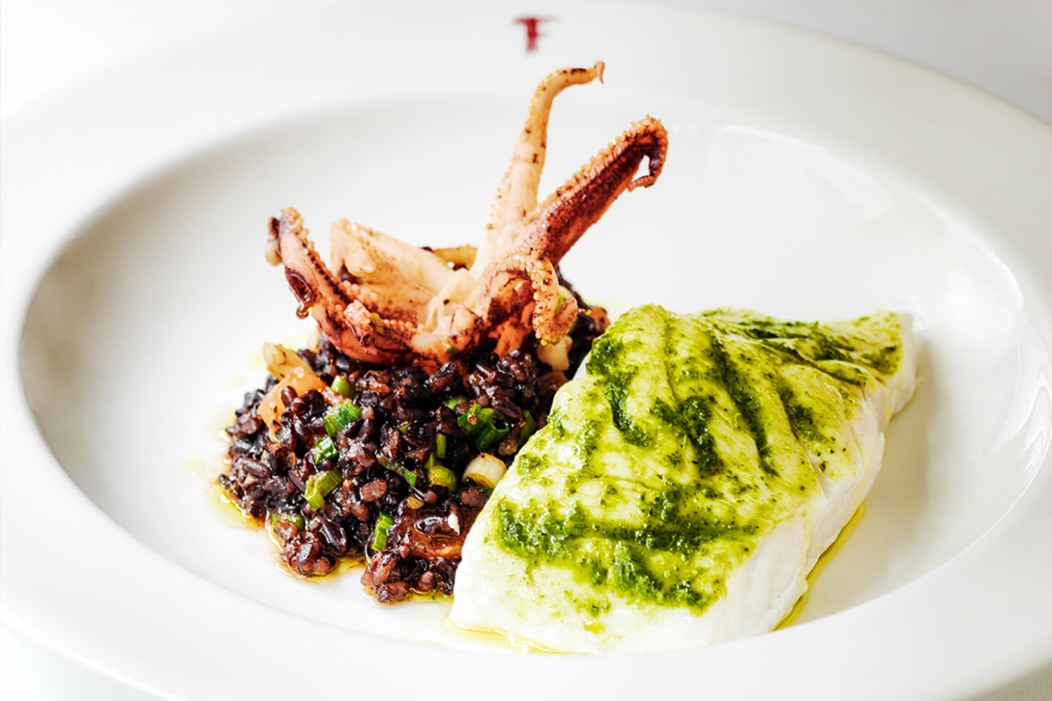 Franco's Restaurant Steamed Hake with Sauteed squid and black rice